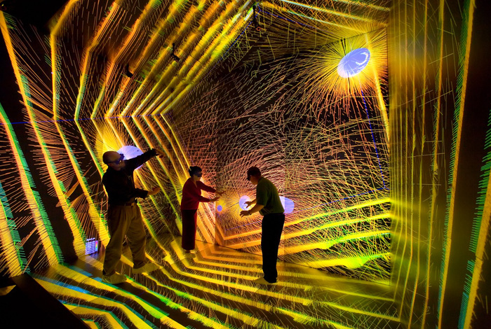 Researchers investigate details of an astronomical simulation in the Cave Automatic Virtual Environment at Los Alamos National Laboratory's Supercomputing Center.