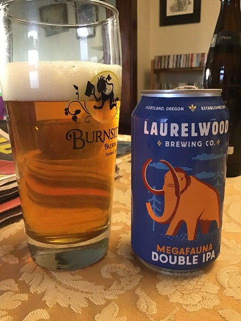 Laurelwood Megafauna DIPA in glass on table, next to can