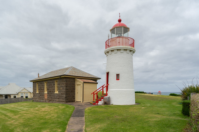Warrnambool Upper Lighthouse & Cottage with the top of the lower lighthouse just visible