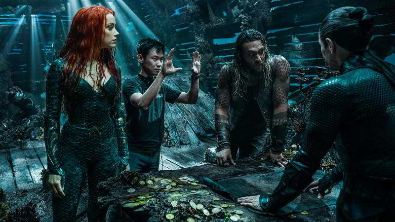The director with the cast of Aquaman