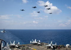 SOUTH CHINA SEA (April 7, 2021) Aircraft from Carrier Air Wing (CVW) 11 and the Royal Malaysian Air Force (RMAF) fly above the aircraft carrier USS Theodore Roosevelt (CVN 71) April 7, 2021. The Theodore Roosevelt Carrier Strike Group is on a scheduled deployment to the U.S. 7th Fleet area of operations. As the U.S. Navy's largest forward-deployed fleet, 7th Fleet routinely operates and interacts with 35 maritime nations while conducting missions to preserve and protect a free and open Indo-Pacific region. (U.S. Navy photo by Mass Communication Specialist 3rd Class Dartañon D. De La Garza)