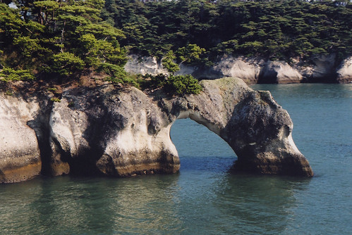 Ferries sailing back and forth from Sendai to Matsushima in Japan do a tour of the unique landforms with sea arches and islets
