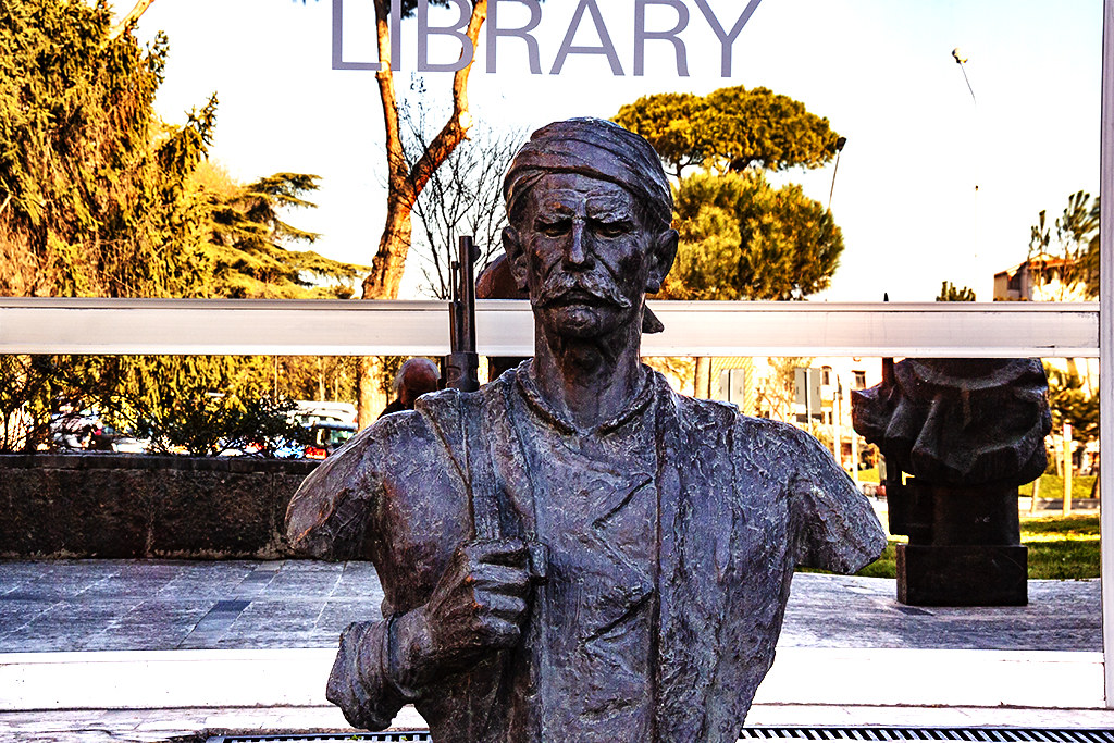 Statue of armed man in front of library--Tirana