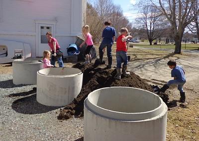 shoveling soil