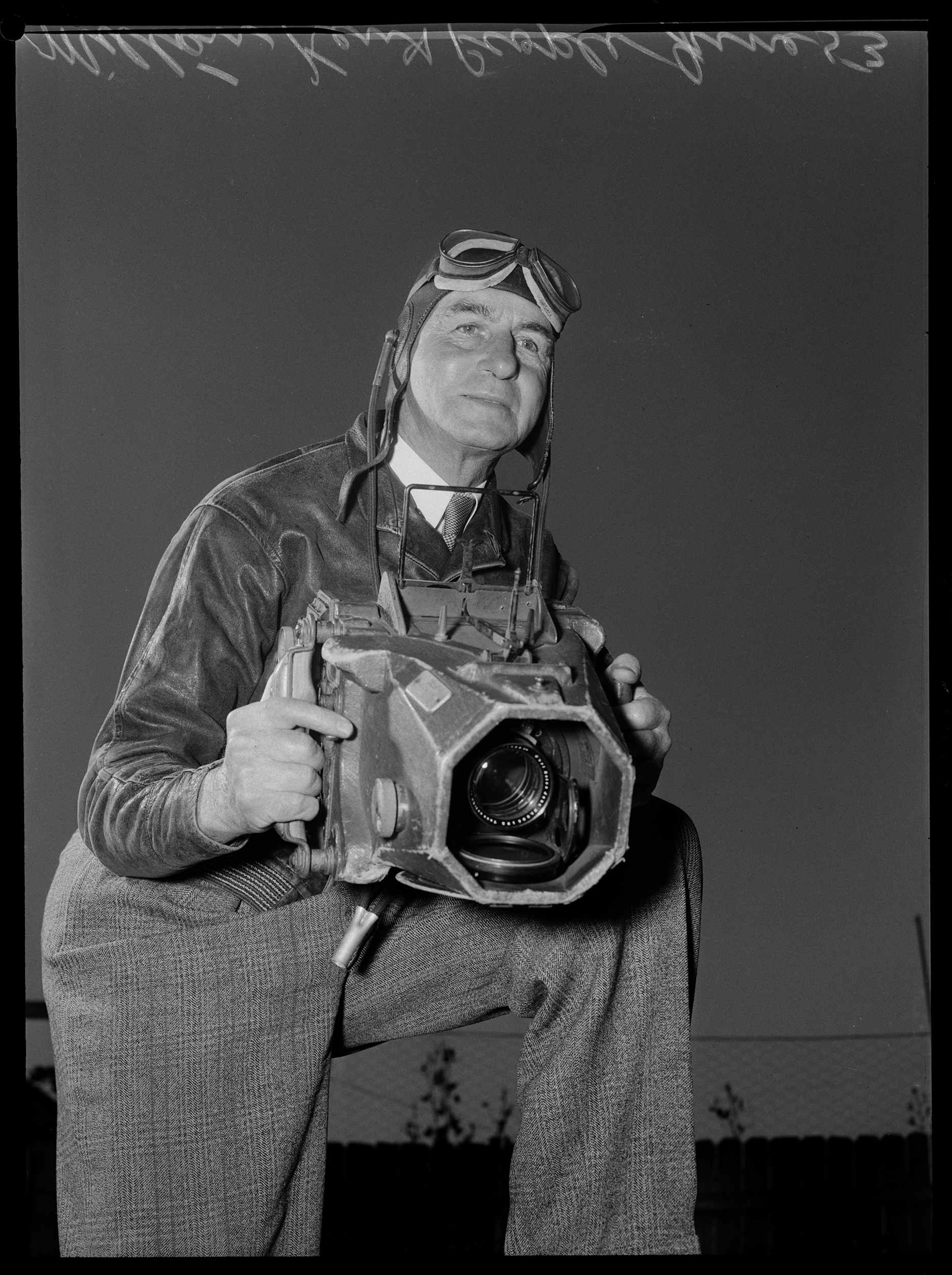 Photographer Milton Kent holding his aerial camera, Sydney, June 1953