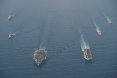 SOUTH CHINA SEA (April 9, 2021) The Theodore Roosevelt Carrier Strike Group transits in formation with the Makin Island Amphibious Ready Group in the South China Sea April 9, 2021. The Theodore Roosevelt Carrier Strike Group, Makin Island Amphibious Ready Group and the Ticonderoga-class guided-missile cruiser USS Port Royal (CG 73) are conducting expeditionary strike force operations during their deployments to the 7th Fleet area of operations. As the U.S. Navy's largest forward-deployed fleet, 7th Fleet routinely operates and interacts with 35 maritime nations while conducting missions to preserve and protect a free and open Indo-Pacific region. (U.S. Navy photo by Mass Communication Specialist 3rd Class Terence Deleon Guerrero)