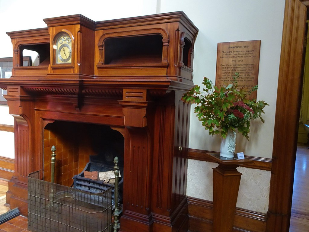 Adelaide. Urrbrae House. Arts and crafts wooden fireplace and clock in the grand hall of Urrbrae House. Built 1891 for sheep pastoralist Peter Waite of Paratoo station. Donated to the SA govt for agricutlural education in 1922.