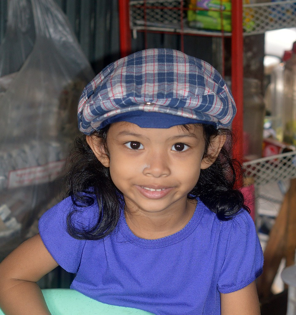 girl with plaid cap