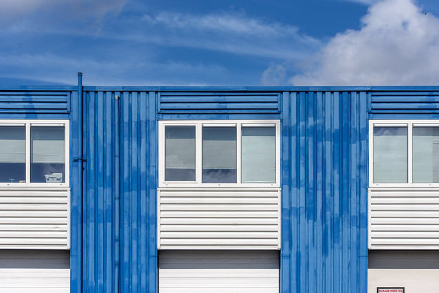 Blue and with facade with lines