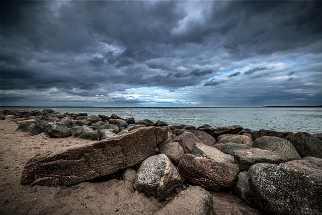 Dark clouds on the beach of the Baltic Sea