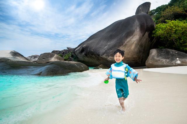Asian boy fun and runing on the beach in Similan island