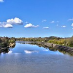 Blue sky and a few clouds over the river at Preston