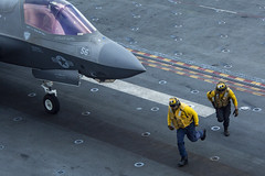 SOUTH CHINA SEA (April 8, 2021) – U.S. Sailors assigned to the amphibious assault ship USS Makin Island (LHD 8) clear out of the way of a U.S. Marine Corps F-35B Lightning II assigned to Marine Medium Tiltrotor Squadron 164 (Reinforced), 15th Marine Expeditionary Unit (MEU), in preparation for takeoff from the flight deck of the ship. The Makin Island Amphibious Ready Group and embarked 15th MEU are operating in the U.S. 7th Fleet area of operations to enhance interoperability with allies and partners and serve as a ready response force to defend peace and stability in the Indo-Pacific region. (U.S. Marine Corps photo by Cpl. Patrick Crosley)