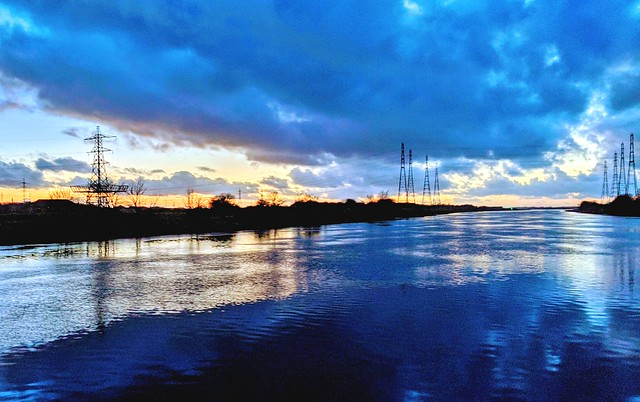 Blue cloud reflections at the Ribble near Preston