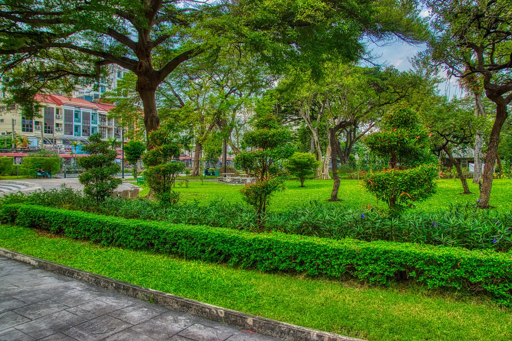 Topiaries and trees in Rommaninat Park on Rattanakosin island (Old Town) in Bangkok, Thailand