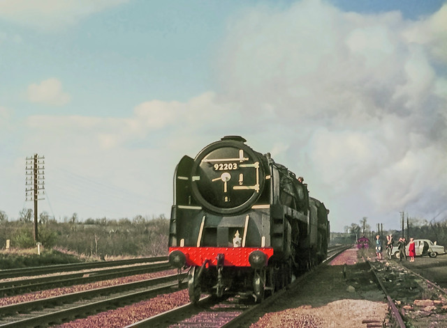 During the last few months of steam on British Railways the artist David Shepherd acquired two locomotives, 9F no. 92203 and 4MT 4-6-0 no. 75029. Here they are seen near St Albans as they make their way to their new home on the Longmoor Military Railway