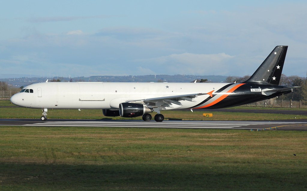 G-NIKO A321P2F Titan Airways Cargo departing on RW25@Belfast International /EGAA to EGSS