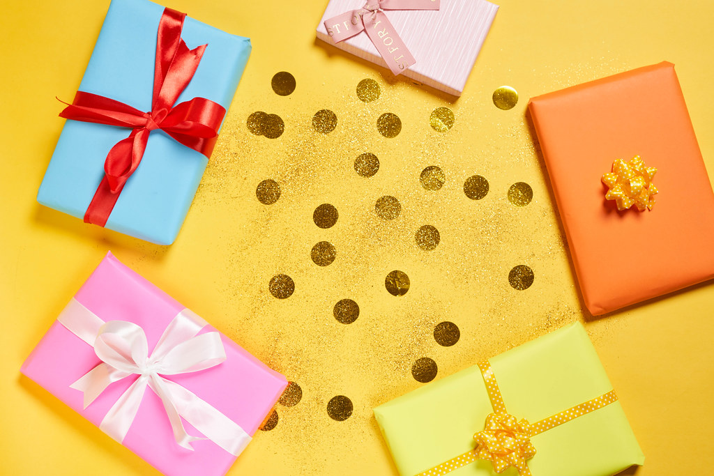 Handmade presents - gift boxes packaged in craft paper and tied with colorful ribbons
