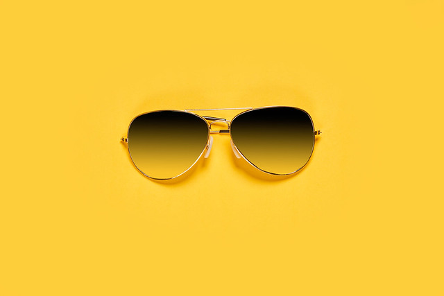Classic sunglasses on bright yellow background