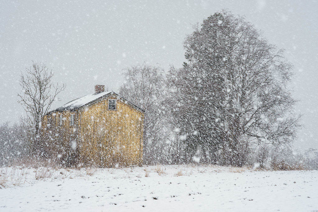 Decaying house in heavy snowfall