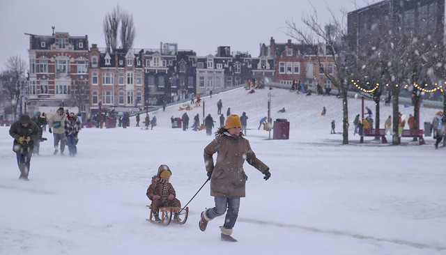 Mother pulls daughter on sledge during Darcy blizzard