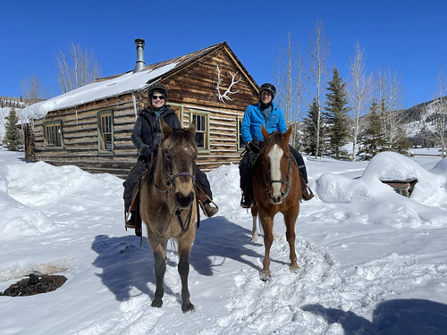 Horseback riding near the relocated homestead cabin. From History Comes Alive at Colorado's Vista Verde Ranch