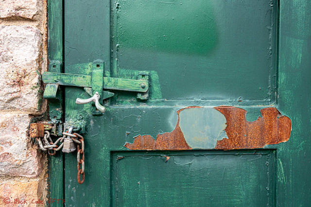 Locked Green Door With Rust