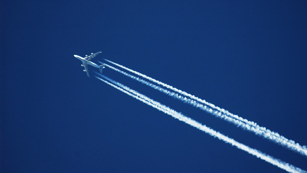 Image of aeroplane high in sky.