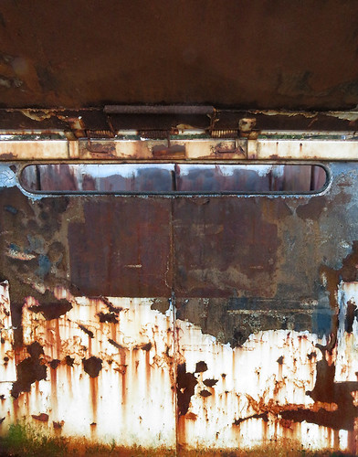abstract of a rusty dumpster an alley