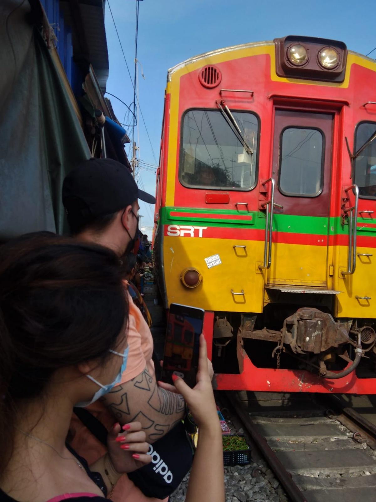 Maeklong Railway Market train passing