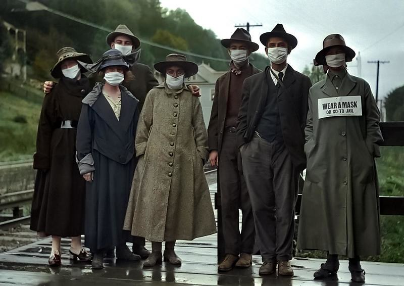 A colorized photo of California commuters in 1918 spreading the message of pro-maskers.