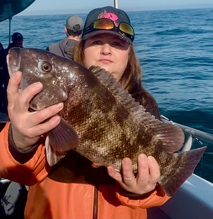 Photo of woman holding a tautog