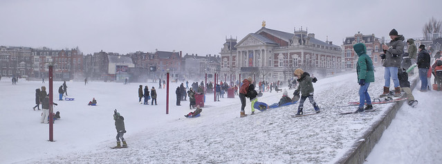 Snowboarding at the snow-covered slope at the Museumplein during Darcy blizzard