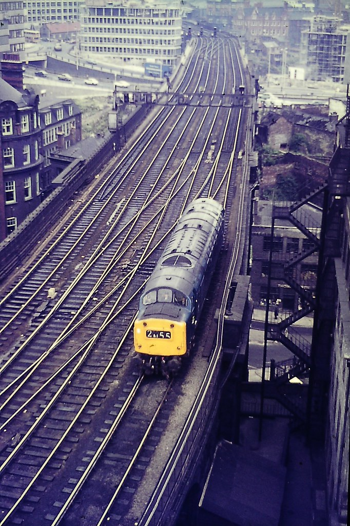One of my dad's slides with one of Haymarket's class 40s in the 260-266 series, passing by light engine below the Castle Keep at Newcastle in the early 1970s.  The All Saints office complex is rising in the background.