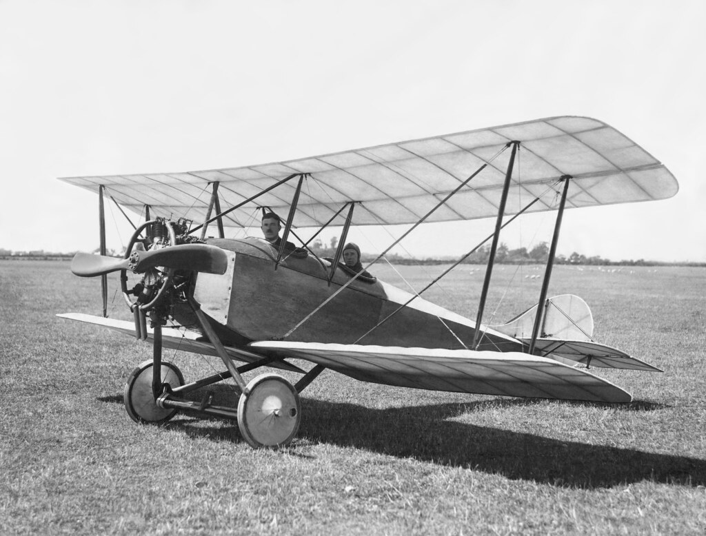 c1919 Canterbury Aviation Company Chief Flying Instructor, Cecil Hill (rear seat) and (probably) the Engineer J Mackie in the Company-built aircraft at Sockburn Aerodrome, Christchurch, NZ,  c1919.