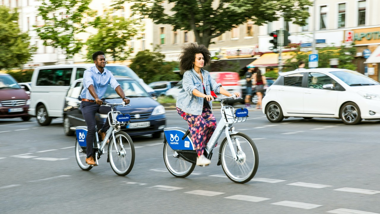 People using public bikes