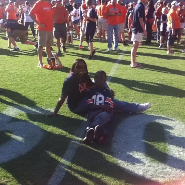 Donovan Evins on the field at Jordan-Hare Stadium with his mother, DeShannon Bogan, in 2013.