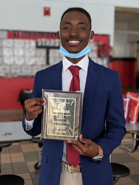 Donovan Evins with his valedictorian plaque