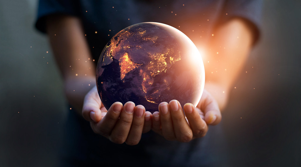 Picture of hands holding a globe