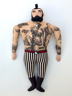 Tattooed Man with top knot