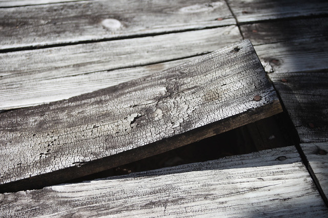 Weathered deck board came loose and needs repair