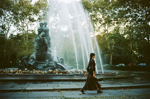 woman walking by the fountain