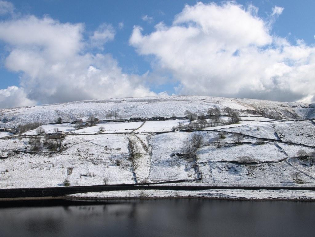 Fresh snow fall on Binn Lodge Farm from across Butterley Reservoir, Wessenden valley Marsden.
