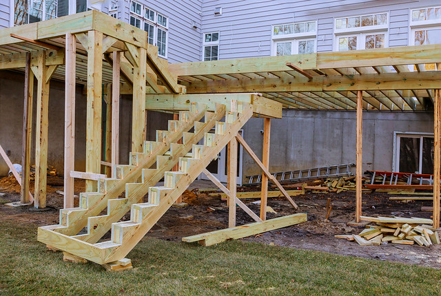 Installing deck boards with above ground deck, patio construction.