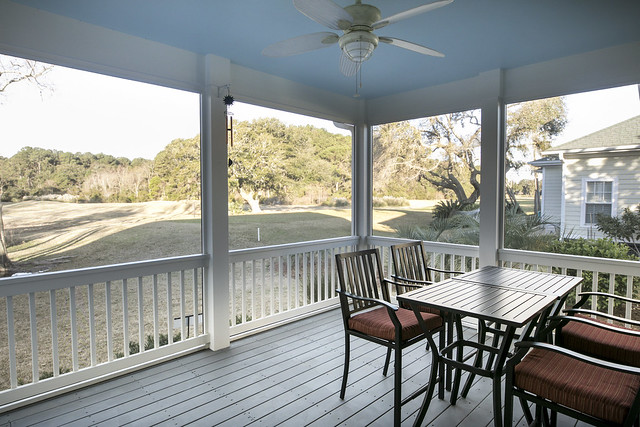 Screen porch with a view of the golf course in the American South.