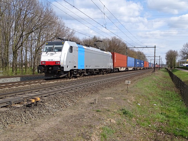 The Clean Railpool Traxx Locomotive in service by RTB Cargo the 186-506 with Blerick Shuttle Container Train at Blerick , the Netherlands 16.4.2021