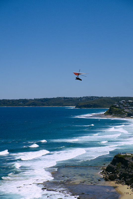 Hangglider above Susan Gilmore Beach, ANZAC Walk, Newcastle