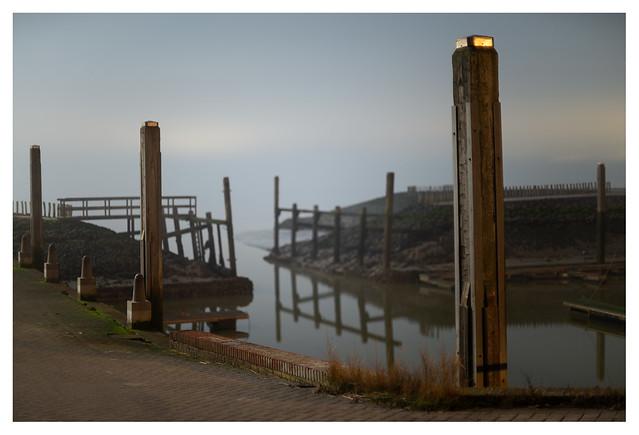 Ellewoutsdijk harbour by night, fog and full moon