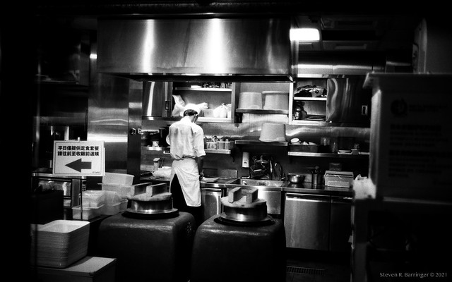 in the shadows of a kitchen
