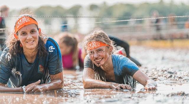 Girls in a pool of mud.